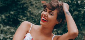 Girl holding hair and laughing.