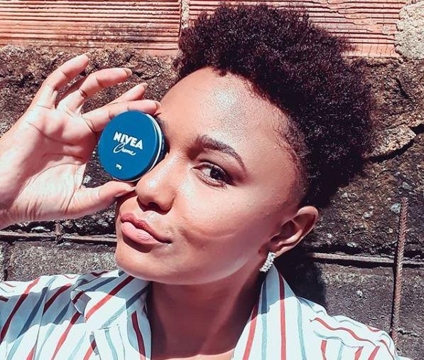 African american woman with nivea creme tin.