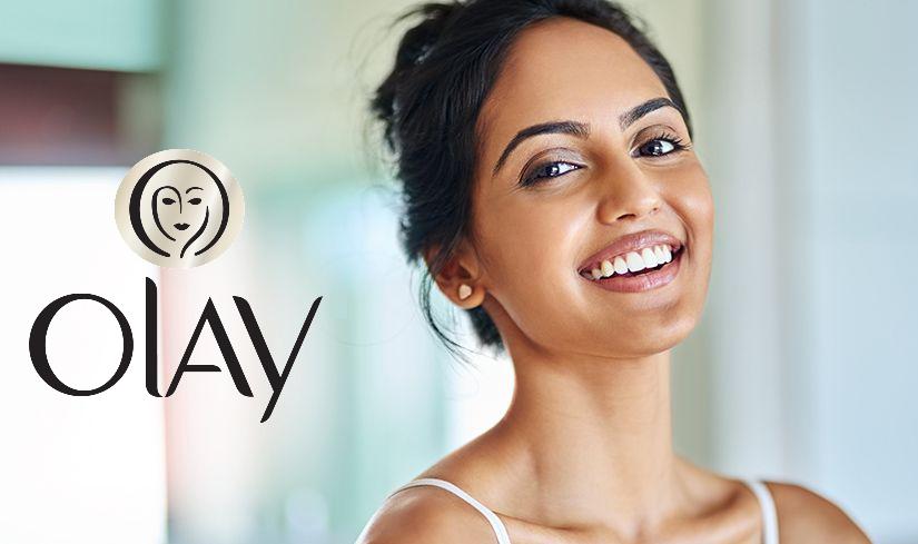 Olay logo next to woman.