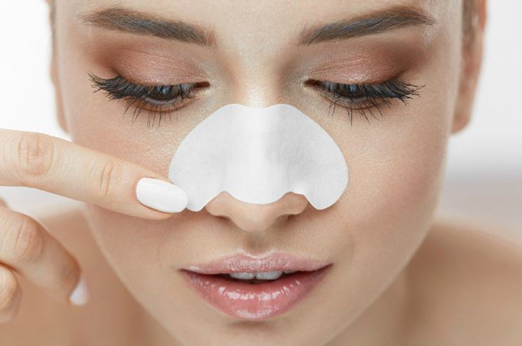 Woman with pore strip on her nose.