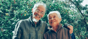 Elderly couple smiling.